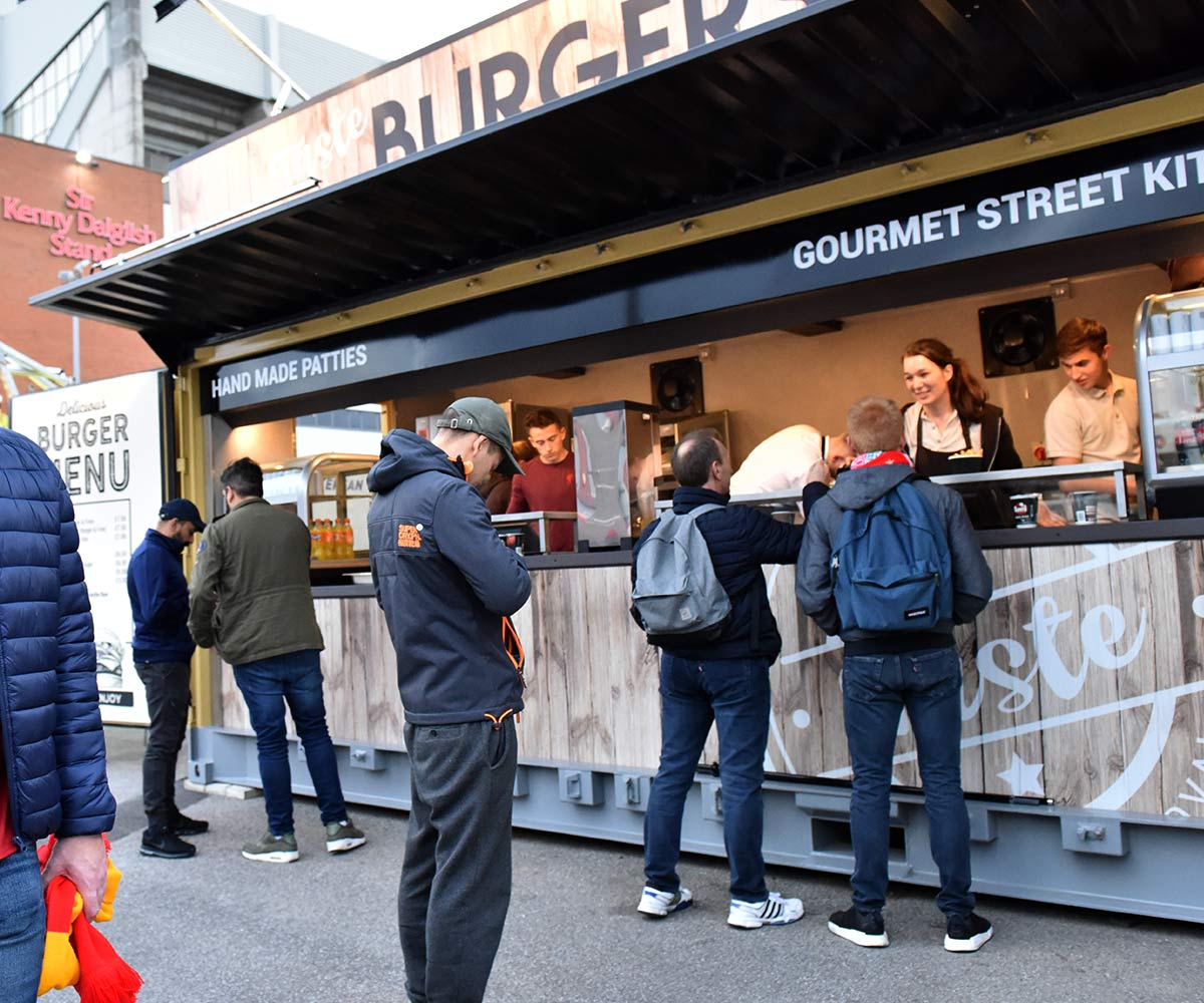 Liverpool FC shipping container food kiosks--Shipping-Container - Taste Burgers - queue
