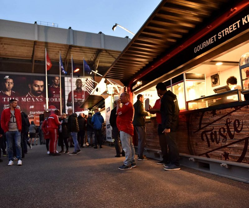 Liverpool FC shipping container food kiosks--Shipping-Container - Taste Pizza night time