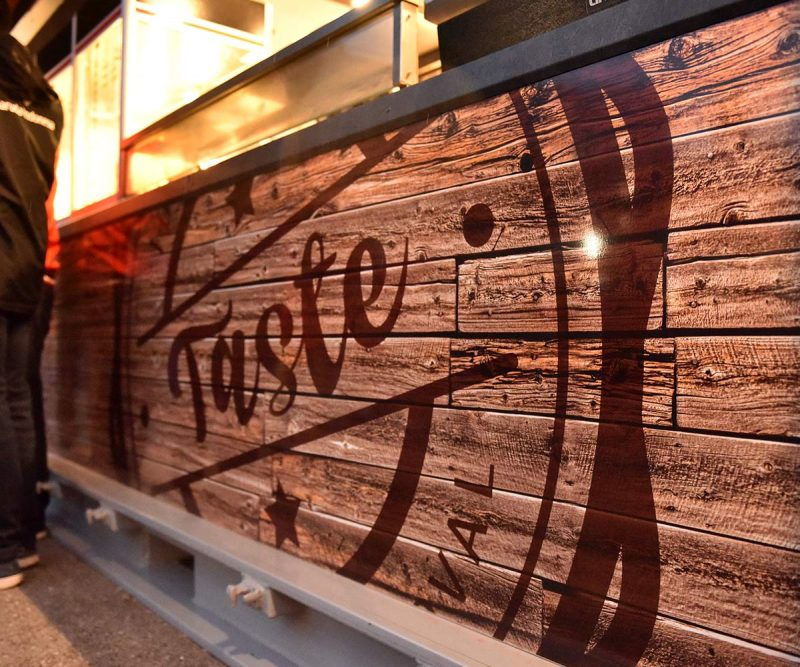 Liverpool FC shipping container food kiosks--Shipping-Container - Taste logo closeup