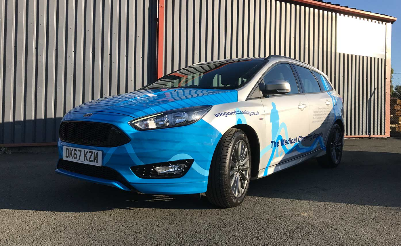 Vanguard Cleaning Ford Focus Vehicle Wrap