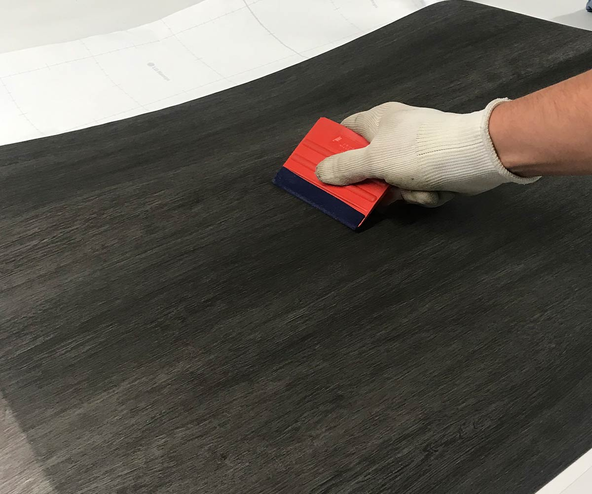Architectural surface refurbishment - vinyl surface wrapping with wood effect vinyl
